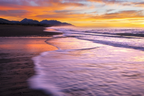 Colorful sunrise over new Zealand coast